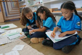 Children working in a Montessori environment.